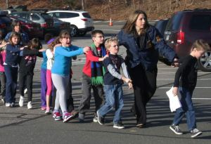 Evacuating horrified children in the wake of Sandy Hook Elementary School shooting