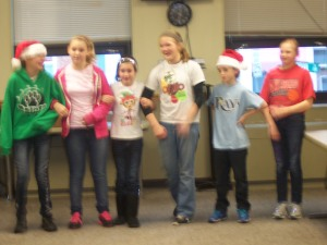 6th Graders singing carols to heal the brokenhearted
