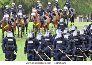 stock-photo-modern-day-gladiators-police-officers-in-riot-gear-respond-to-the-civil-disturbance-13055026