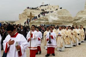 Catholic pilgrims attend mass at the baptism site on Jordan River