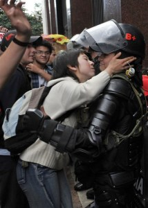 Protester kissing riot police