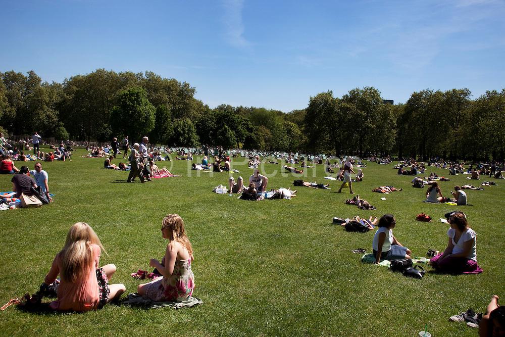 UK - London - People lying in the sun in Green Park