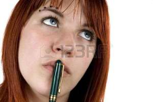 2297075-cute-girl-with-redhair-pensive-with-pen-on-her-lips